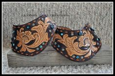 Custom Dove Wing spur straps for sponsored riders, turquoise crystals rivets and rimsets.