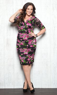 Florals are made sexy in curve hugging Plus Size Betsey Ruched Dress by Kiyonna. #plussize #kiyonna