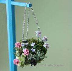 Make traditional styled moss hanging baskets in miniature