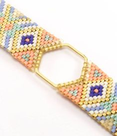 Hexagon bracelet Miyuki beads white, gold, salmon, sky blue and Royal Blue and gold. Bead Loom Patterns, Bracelet Patterns, Bracelet Designs, Bead Jewellery, Beaded Jewelry, Royal Blue And Gold, White Gold, Blue Gold, Gold Armband