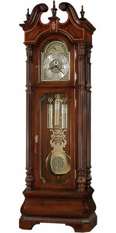 """The Howard Miller Eisenhower 611-066 is a grand Presidential floor clock with many outstanding features. A hand-built clock using Rare and Exotic woods throughout the case. The swan neck pediment displays bookmatched crotch figured veneers framed with a V-matched movingue border. Cable-driven, triple chime Kieninger movement offers automatic nighttime chime shut-off option.  Size: H. 92-1/4"""" W. 29-1/2"""" D. 18-3/4"""""""