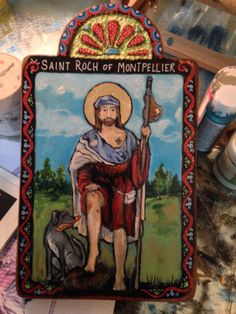 This is my latest Retablo of Saint Roch patron St of dogs and dog lovers!  www.etsy.com/shop/art4thesoul