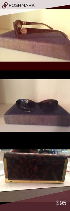 Authentic Tory Burch sunglasses Authentic Tory Burch sunglasses. Non polarized. Dark brown frames. Comes with the tortoise case and the protective cloth bag. Tory Burch Accessories Sunglasses