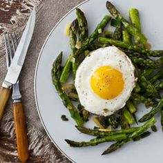 Panfried Asparagus with Ramps, Lemon, and Fried Eggs from Cook This Now by Melissa Clark  Ramps are a kind of wild onion