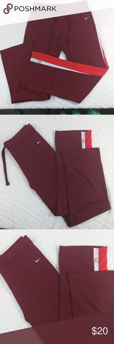 "Nike women's athletic long track pants Sz M EUC. 100% polyester. Waist 16"" flat, hips 19"" flat, insem 30.5 Size M (8-10) Color: Burgundy with 2 lines on the left size color white and red Nike Pants Track Pants & Joggers"