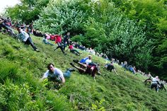 Top 7 Most Bizarre Festivals around the World Cheese Rolling. This annual festival is held at Cooper's Hill in England. The participants used to be only from the nearby village of Brockworth, but over t. Festivals Around The World, Travel Around The World, Around The Worlds, Festival List, Beer Festival, World's Best Food, Local Pubs, Cheese Rolling, United Kingdom