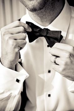 Snap a shot of your groom adjusting his tie so he can show off his wedding ring too! | Wedding Photography