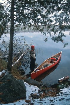 Look at this - snow on the ground, water like glass, red canoe. Now that's Canada (even though this photo wasn't necessarily taken in Canada).
