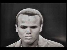 Harry Belafonte - Island in the Sun and other of his works.  Had the pleasure to meet him in person when working with UNICEF.  A very unpretentious man, and very nice person.
