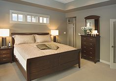 Master bedroom from the Vandenberg Plan 746-D www.dongardner.com - The master bedroom is topped by a tray ceiling and features a lovely private bath and walk-in closet. A versatile bedroom/study and full bath are nearby. Downstairs are two more bedrooms, each with an adjacent covered patio, another full bath, and a generous family room with fireplace.  #Master #Bedroom #Modern