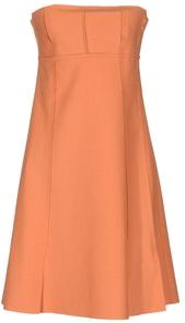 Sleeveless solid color orange dress.
