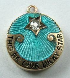 An Edwardian gold a enamel lucky-star locket charm depicting a star and the words 'THIS BE YOUR LUCKY STAR' below. (Sandy's Vintage Charms)