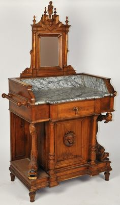 Very beautiful washstand. The pitcher and bowl would sit on the marble insert.