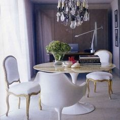 Marble-top table + baroque chairs + table-top shrubbery + chandelier = breakfast nook