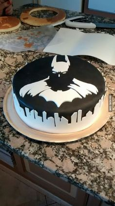 Batman cake. That's epic! I wouldn't even eat it, just stare at it.