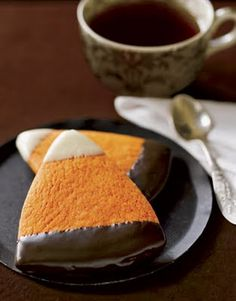 Halloween treat. White and dark chocolate dipped cookies for candy corn
