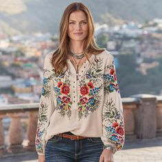 """EVERLASTING BOUQUET TOP - PETITES--Our exquisite top with billowing sleeves and elastic cuffs flourishes with bright, flower embroidery. Shirring at neckline, sleeves and back. Modal. Machine wash. Imported. Exclusive. Sizes XS (2), S (4 to 6), M (8 to 10), L (12 to 14). Approx. 25""""L."""