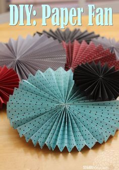 Sugar Blossoms: DIY: Paper Fans Here's what you'll need to make 1 large fan: 3- 12x12 pieces of paper (same design/print) glue gun....fishing line (optional; for hanging from the ceiling)