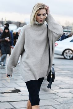 Don't call it a sweaterdress. Why this season's most alluring sweater works with every possible fall ensemble.