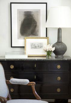Beautiful black dresser. Looks like a semi-gloss finish. The hardware is amazing.