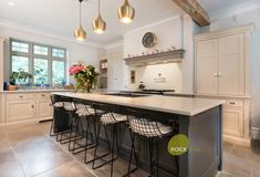 The Paris Grey Carrara is featured in this kitchen, which has a stunning vein flowing throughout. This is a very large kitchen that has been handmade by a company we know and work with. A very large island sits in the middle of this space making it the perfect entertaining area.
