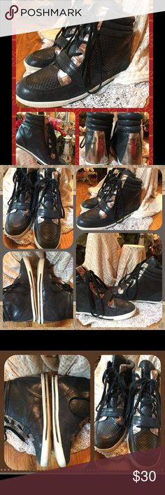 Vince Camuto Black/ Silver High Top Sneakers  9M Preowned, Vince Camuto, black with silver trim, leather, high top sneakers.  They are a size 9M in very good condition.  They do show signs of wear mostly on the rim and soles of the shoes. Otherwise they look great.  Please look at all pictures.  Request more pictures or ask questions. Offers encouraged. No holds or trades, please.  From  smoke free home with pets. Vince Camuto Shoes Sneakers
