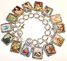 $89 Silver tone chunky religious charm bracelet with 14 Catholic Saints. The colored acrylic covered and silver metal Charms / Medals are approx. 1 inch long and 3/4 inch wide and include:  St. Catherine of Siena,  St. John the Baptist,  St. Joseph,  St. Michael the Archangel,  St. Nicholas,  St. Patrick,  St. Peter,  St. Therese of Liseaux,  St. Thomas Aquinas,  St. Francis of Assisi,  St. Elizabeth Ann Seton,  St. Juan Diego,  Sacred heart of Jesus,  The Blessed Mother Virgin Mary.