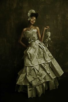 People will recycle anything these days in the name of fashion.  Recycled Newspaper dress. I gotta say pretty awesome!