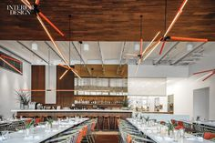 Rene Gonzalez Architect wrapped the main dining area at Miami's Plant Food + Wine in bamboo plywood.Photography by Michael Stavaridis.