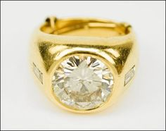 A MAN'S DIAMOND AND 14 KARAT YELLOW GOLD RING. Lot 150-7030 #jewelry #diamond #gold