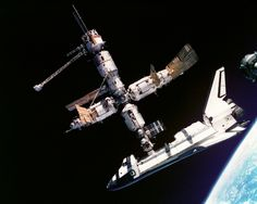 Space Shuttle Atlantis while docked with the Mir Space Station photographed by the Mir-19 crew on July 4 1995. The picture was taken by Cosmonauts in a Soyuz performing a visual inspection of Mir and Atlantis. [3000 2400]