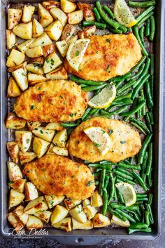Oven baked and CRISPY breaded Sheet Pan Lemon Parmesan Garlic Chicken & Veggies, complete with potatoes and green beans smothered in a garlic butter sauce! | http://cafedelites.com