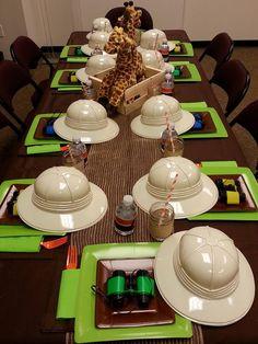 Safari hats and binoculars at safari party