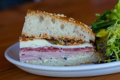 Muffuletta Sandwich--This delectable delight is filled to the brim with ham, salami, housemade mortadella, provolone, olive salad, and mixed greens. Depending on how much you plan to chow, Boxing Room offers this mouth-watering sandwich in three different sizes. Another plus? This delicious sandwich comes with a yummy salad. We recommend sharing a half with a friend!--Boxing Room, 399 Grove Street (at Gough Street), 415-430-6590.