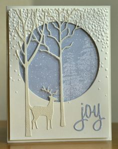 handmade winter card: Falling Snow and Stag ... vanilla and baby blue ... porthole to winter forest ... delicate leafless trees die cut ... luv it!
