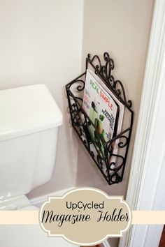 Mail Carrier turned magazine holder! Perfect for small powder rooms and little floor space.
