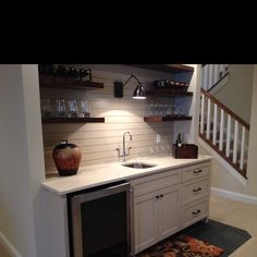Nice basement wet bar, with open shelves