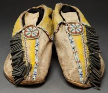 Beadwork and Quillwork, A PAIR OF COMANCHE BEADED HIDE MOCCASINS. c. 1880...