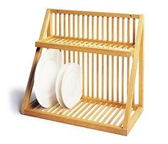 The Smaller Plate Rack is a traditional wall-mounted plate rack that air dries washed plates and cups. Hand-made in England. http://ancientindustries.com/shop/products/smaller-wooden-plate-rack
