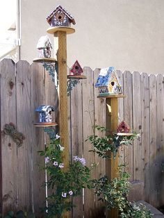 Birdhouse Condo -- Each birdhouse is created in mosaics with broken China, handmade tiles and glass beads. (Artist: Suzanne Noll of Animal Instincts Art)