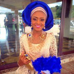 Champagne colored lace with Cobalt blue/Gold Aso Oke Gele, blue hand fan, Gold/Blue jewelry  ♡! Makeup and gele by @ujubaby007 #fabricsby#Boonfabrics #NWglam #makeupandgele #nigerianwedding #crystaljewelry #beadjewelry #smile #nigerianweddingpictures #nigerianmakeupartist #cobaltblue #asoebi #handfan