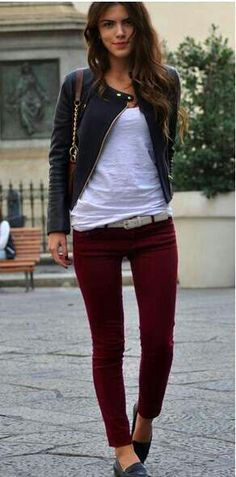 black moto jacket, white tee, and burgundy trousers