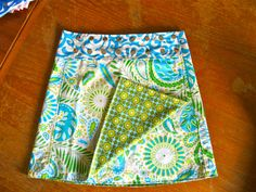 "Li'l Skirts Jenny Sassy Reversible Wrap Skirt Ladies by Lilskirts. 100% cotton print with 100% Cotton Canvas. 3"" yoga style waistband. Skirt measures 17"" overall length. Two skirts in one. Love the idea of the snaps so that you can adjust it to fit. #wrapskirt #SewforMe"