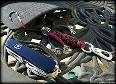 "https://flic.kr/p/uzq5h7 | Paracord wrist lanyard... | Paracord wrist lanyard in round crown sinnet with wall knot, two-strand stopper knot, made in USA swivel clip, with Schmuckatelli Co. Vinnie Garoon Cowboy Beads in standard and mini sizes, attached to a limited edition Victorinox Yeoman MS from SwissBianco.  <a href=""http://www.scskulls.com"" rel=""nofollow"">www.scskulls.com</a>  <a href=""http://swissbianco.com/"" rel=""nofollow"">swissbianco.com/</a>"