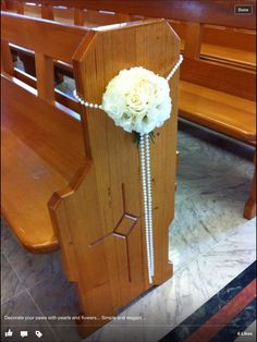 Pew decoration. Aisle decoration. Rose pomander with pearls. Pretty!