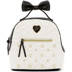 Betsey Johnson Chevron Heart Quilted Medium Backpack ($40) ❤ liked on Polyvore featuring bags, backpacks, quilted backpack, faux-leather backpacks, chevron print backpack, zip top bag and pocket backpack