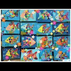 折り紙のウロコがカラフルでおもしろい、絵本『にじいろのさかな』から生まれた7月の壁面