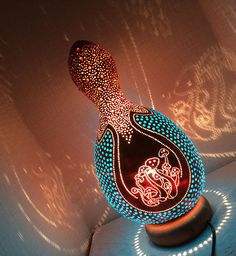 This lamp which I named Psilocybin is a combination of drilling and beading work with a focus on the side sectio where the gourd is filled with blue beads. Diy And Crafts, Arts And Crafts, Gourd Lamp, Spring Photography, Painted Gourds, Diy Crystals, Nature Crafts, Punch Art, Blue Beads
