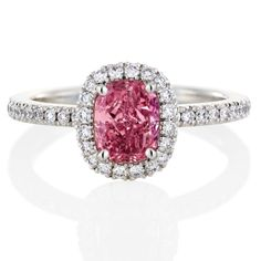"""Brides.com: Engagement Rings with Colored Stones. Style 9146, """"Pink Cushion Aura"""" platinum engagement ring with a pink, cushion-cut diamond solitaire surrounded by micropavé diamonds, price upon request, De Beers  See more De Beers engagement rings."""