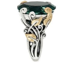 A fine vine. A beautiful, oval fluorite sits atop this sterling silver vine-designed band, accentuated with 18K yellow gold leaves. From Barbara Bixby.<br><br>For more details on this ring's fit, please refer to the Ring Size Guide above. QVC.com